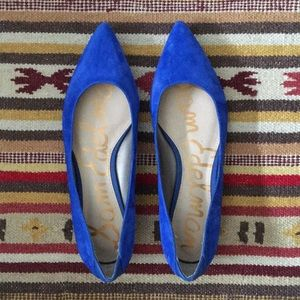 Suede royal blue flats with a leather bottom.